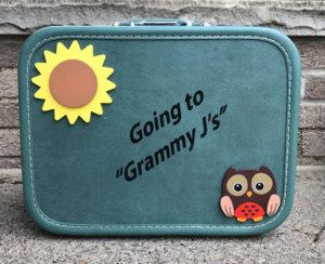 vinyl lettering on suitcase