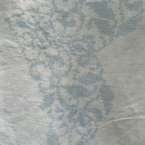 cross stitched table cloth